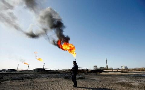 A policeman is seen at West Qurna-1 oilfield, which is operated by ExxonMobil, in Basra - Credit: REUTERS/Essam al-Sudani/File Photo