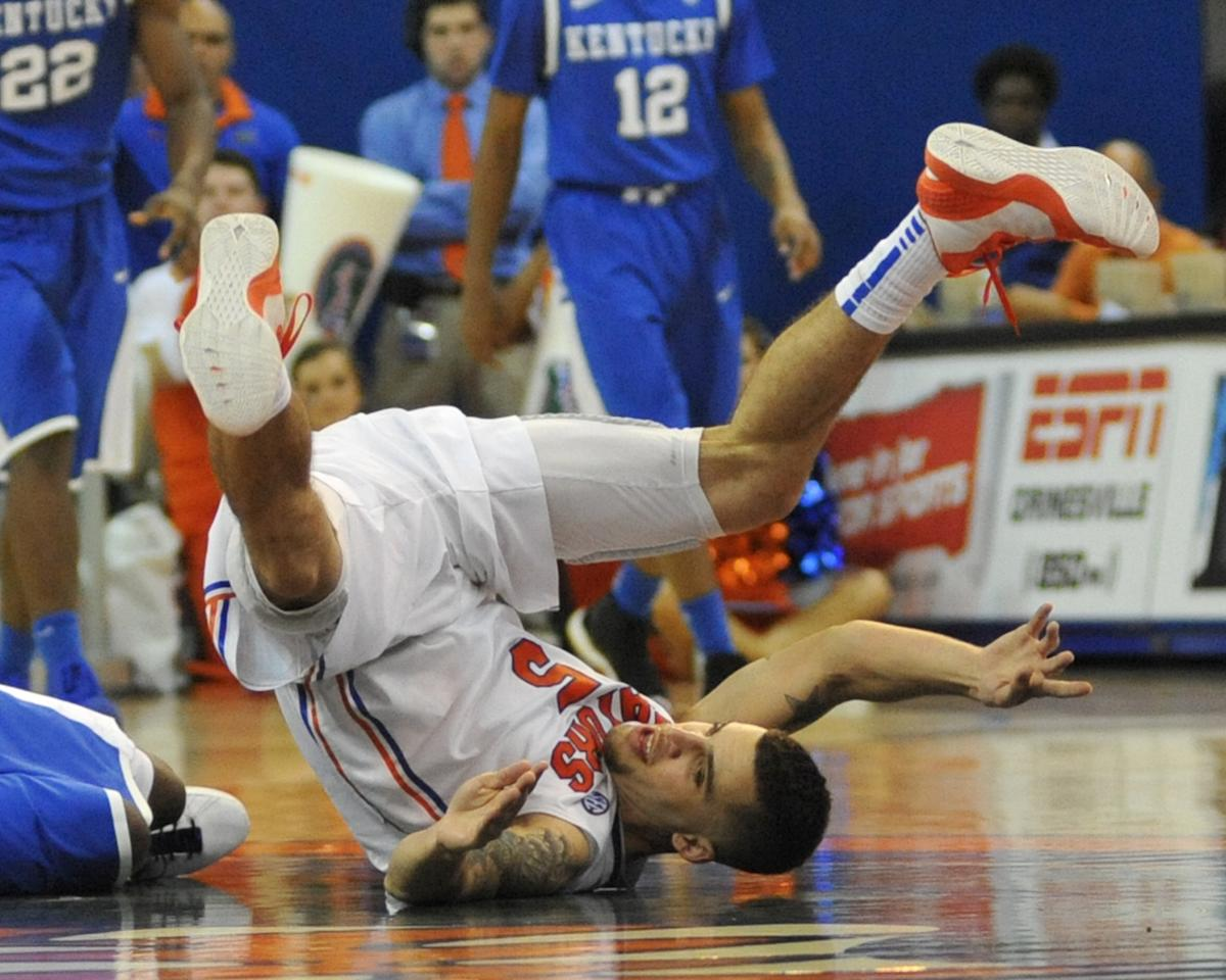 Scottie Wilbekin of the Florida Gators tumbles against the Kentucky Wildcats February 12, 2013 at Stephen C. O'Connell Center in Gainesville, Florida. The Gators won 69 - 52. (Photo by Al Messerschmidt/Getty Images)