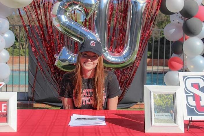 Woodland Hills Louisville softball standout Grace Luderer smiles during a signing day ceremony for Seattle University.