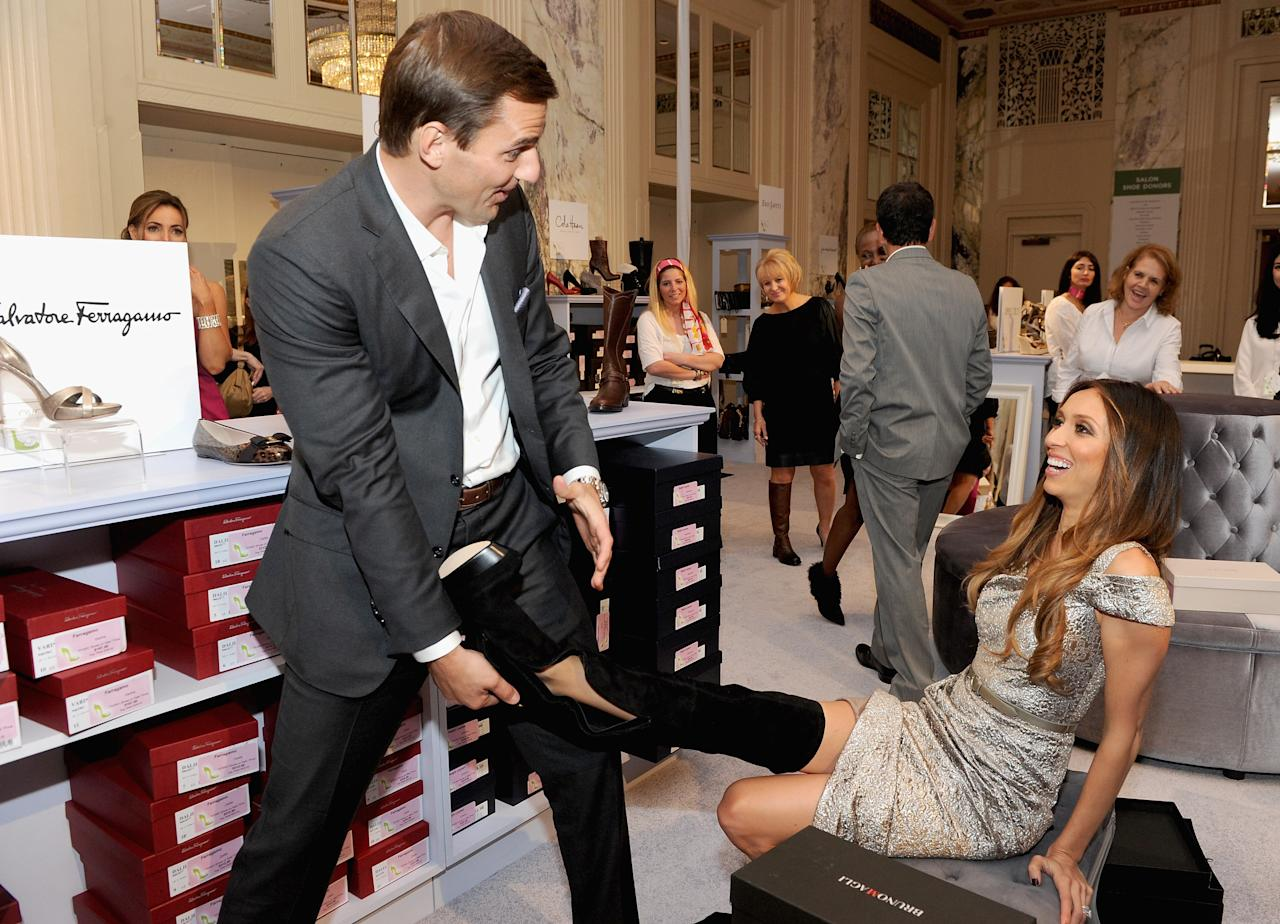 "NEW YORK, NY - OCTOBER 13:  Bill Rancic and Giuliana Rancic attend the 18th Annual QVC ""FFANY Shoes On Sale"" at The Waldorf=Astoria on October 13, 2011 in New York City.  (Photo by Jamie McCarthy/Getty Images)"