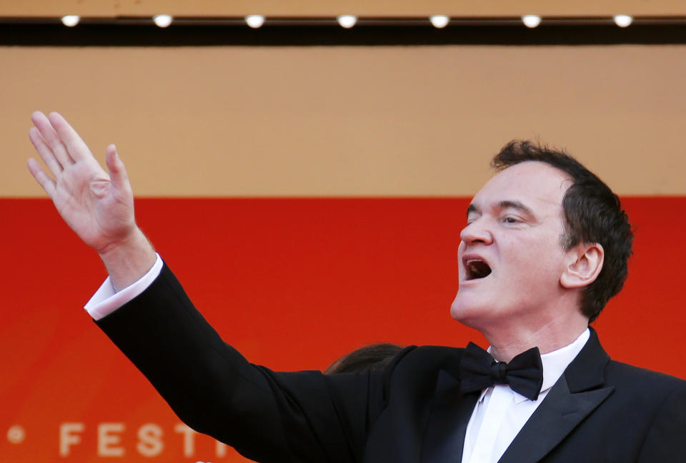"""72nd Cannes Film Festival - Closing ceremony and screening of the film """"Hors normes"""" (The Specials) out of competition - Red Carpet Arrivals - Cannes, France, May 25, 2019.  Quentin Tarantino gestures. REUTERS/Jean-Paul Pelissier"""