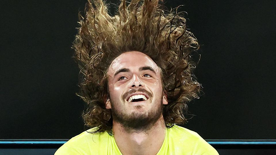 Pictured here, Stefanos Tsitsipas lets his hair down after a thrilling win against Rafael Nadal.