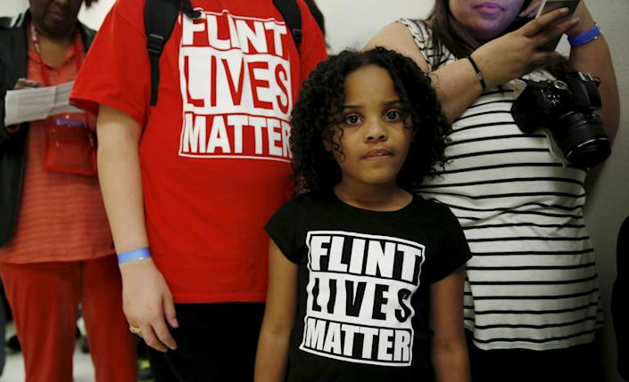 Mari Copeny, 8, of Flint, Michigan, waits in line to enter a hearing room where Michigan Governor Rick Snyder (R) and EPA Administrator Gina McCarthy will testify before a House Oversight and government Reform hearing on