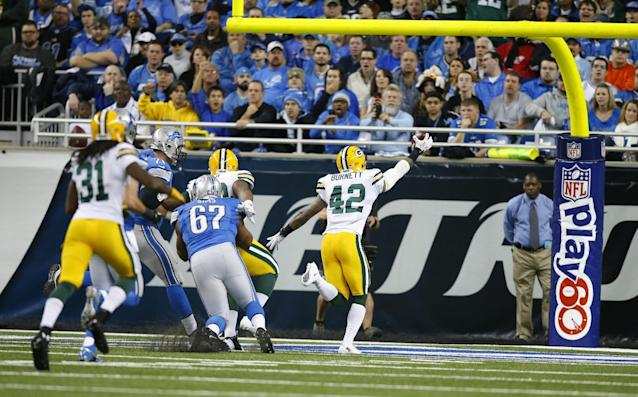 Green Bay Packers strong safety Morgan Burnett (42) runs into the end zone for a touchdown after his fumble recovery during the second quarter of an NFL football game against the Detroit Lions at Ford Field in Detroit, Thursday, Nov. 28, 2013. (AP Photo/Duane Burleson)