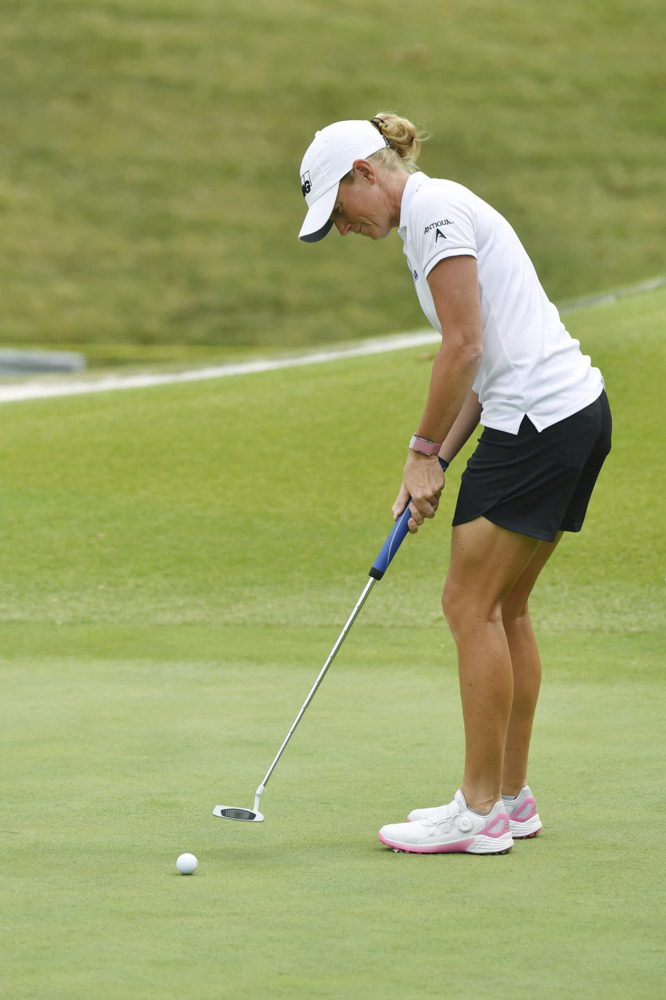 Stacy Lewis makes her putt on the 18th green during the first round of the LPGA Walmart NW Arkansas Championship golf tournament, Friday, Sept. 24, 2021, in Rogers, Ark. (AP Photo/Michael Woods)