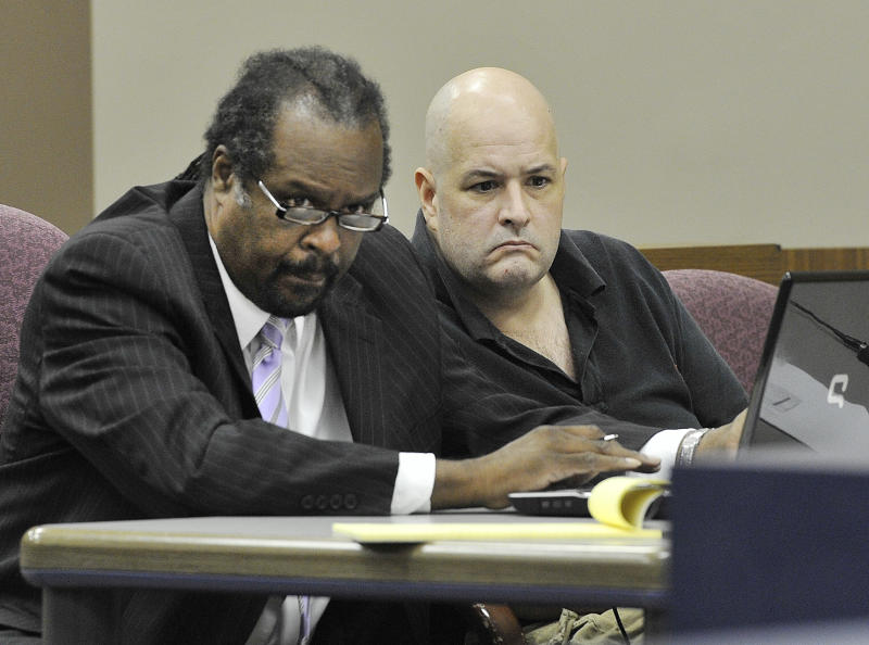Defense attorney Mark Brown and suspect Roger Bowling, right, listen during a preliminary examination at the 24th District Court in Allen Park, Mich. on Monday, Aug. 20, 2012. Bowling is a suspect in the murders of Chris Hall and Danielle Greenway, whose dismembered remains were found in the Detroit River. (AP Photo/The Detroit News, Daniel Mears)