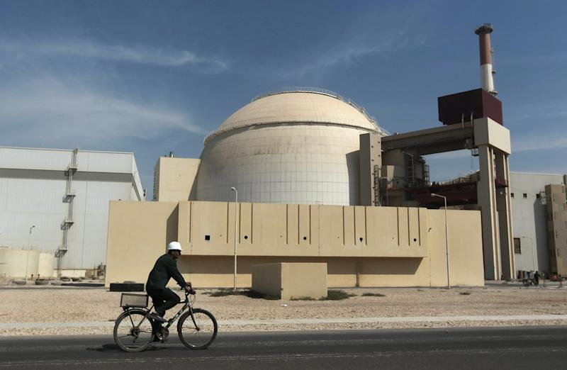 "FILE - In this Oct. 26, 2010 file photo, a worker rides a bicycle in front of the reactor building of the Bushehr nuclear power plant, just outside the southern city of Bushehr, Iran. Ahead of the start of a nuclear deal between Iran and world powers, an official in the Islamic Republic has called limiting uranium enrichment and diluting its stockpile the country's ""most important commitments."" (AP Photo/Mehr News Agency, Majid Asgaripour, File)"