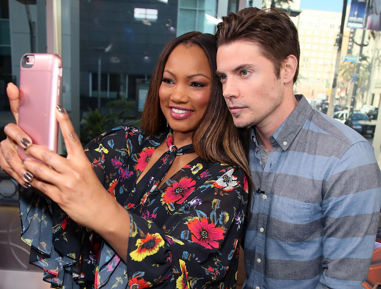 <p>Garcelle Beauvais and Josh Henderson cozy up for a quick picture at <i>Hollywood Today Live </i>on Friday in Hollywood. </p>