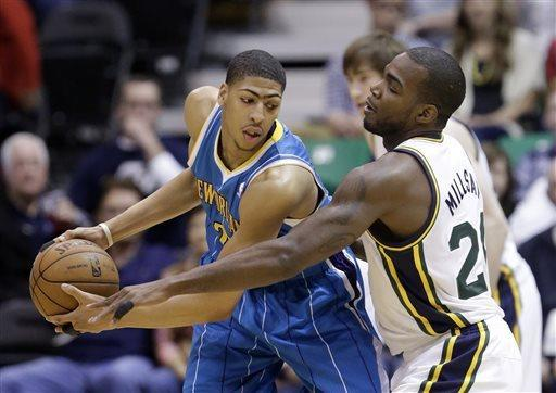Utah Jazz's Paul Millsap, right, guards New Orleans Hornets' Anthony Davis during the first quarter of an NBA basketball game Friday, April 5, 2013, in Salt Lake City. (AP Photo/Rick Bowmer)