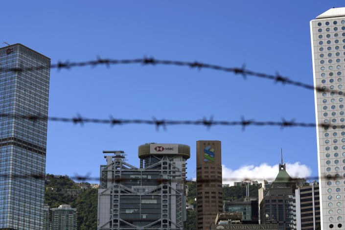 In this Wednesday, Sept. 8, 2021, photo, Commercial buildings are seen in Hong Kong. Banks in Hong Kong, Macao and China's Guangdong province can expect to launch investment products that are open to residents in these areas as soon as October, according to Hong Kong's monetary authority. (AP Photo/Kin Cheung)