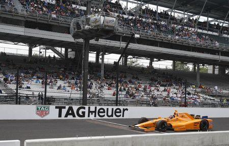 May 20, 2017; Indianapolis, IN, USA; Verizon IndyCar Series driver Fernando Alonso drives across the yard of bricks during qualifying run for the 101st Running of the Indianapolis 500 at Indianapolis Motor Speedway. Mandatory Credit: Brian Spurlock-USA TODAY Sports