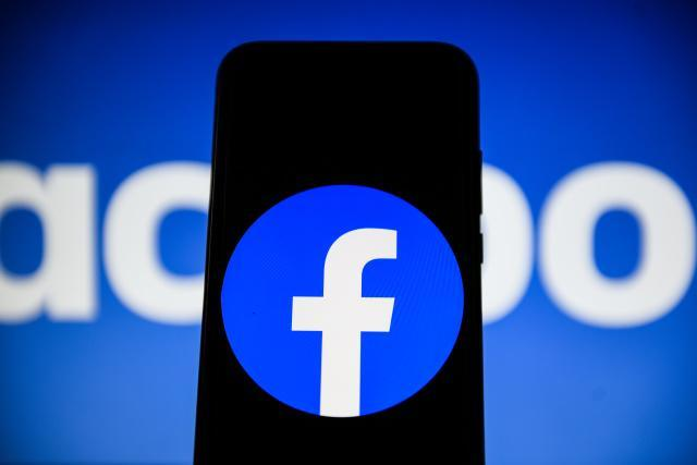 POLAND - 2020/02/17: In this photo illustration a Facebook logo  seen displayed on a smartphone. (Photo Illustration by Omar Marques/SOPA Images/LightRocket via Getty Images)