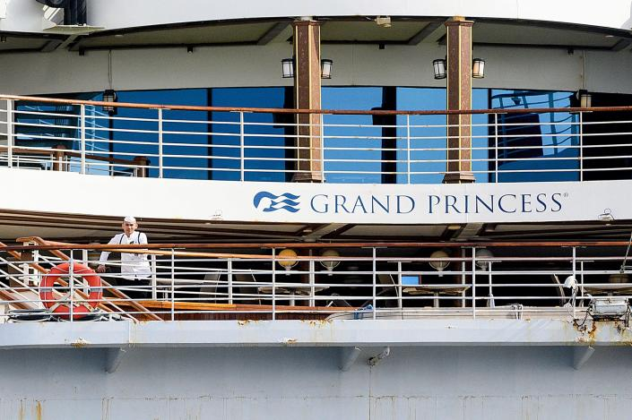 9 Passengers look out from balconies aboard the Grand Princess as it cruises a holding pattern about 25 miles off the coast of San Francisco on Sunday, March 8, 2020.