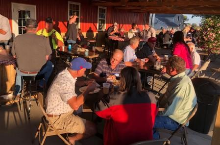 """Farmers and those who sell them seeds, chemicals and equipment gather at a """"Prevent Plant Party"""" after heavy rains disputed plantings this spring in Deer Grove"""