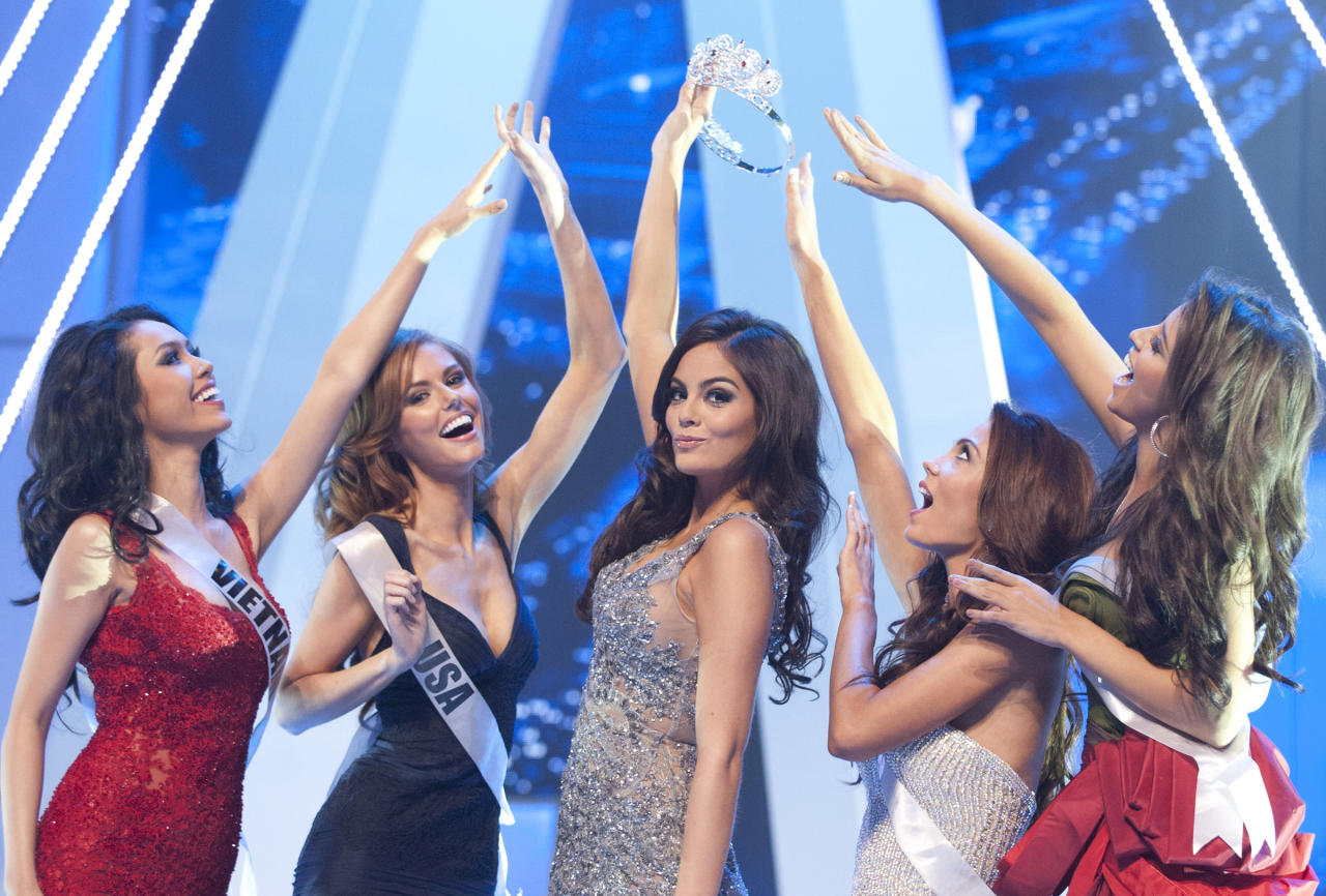 In this image released by Miss Universe Organization, L.P. LLLP, Miss Universe 2010, Ximena Navarrete, center, teases contestants, from left, Miss Vietnam 2011 Hoang My Vu, Miss USA 2011 Alyssa Campanella, Miss Sweden 2011 Ronnia Fornstedt, and Miss Russia 2011 Natalia Gantimurova, with the crown onstage during dress rehearsal of the 2011 Miss Universe Competition at Credicard Hall in Sao Paulo, Brazil, Monday Sept. 12, 2011. (AP Photo/Miss Universe Organization, L.P. LLLP)