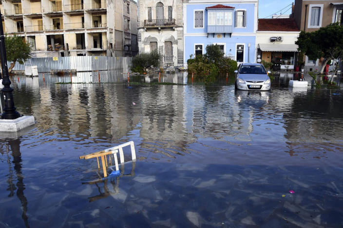 Seawater covers a road after an earthquake at the port of Vathi on the eastern Aegean island of Samos, Greece, Friday, Oct. 30, 2020. A strong earthquake struck in the Aegean Sea between the Turkish coast and the Greek island of Samos as the magnitude 6.6 earthquake was centered in the Aegean at a depth of 16.5 kilometers, or 10.3 miles.(AP Photo/Michael Svarnias)