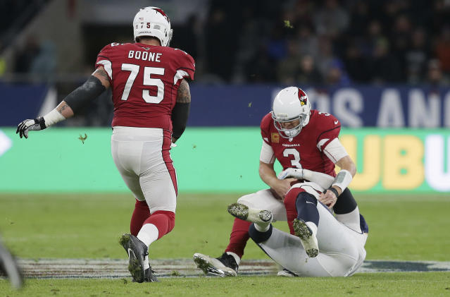 Cardinals quarterback Carson Palmer is sacked during the first half of Sunday's game with the Los Angeles Rams. (AP)