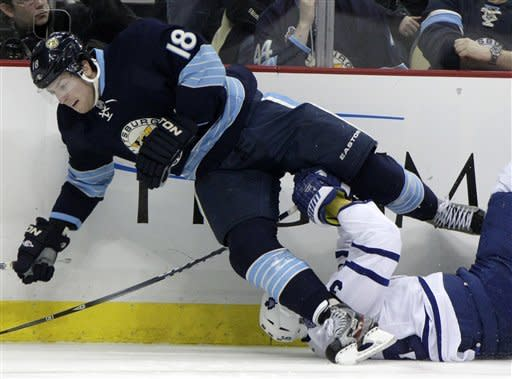Pittsburgh Penguins' James Neal (18) collides with Toronto Maple Leafs' Carl Gunnarsson during the second period of an NHL hockey game in Pittsburgh on Wednesday, March 7, 2012. (AP Photo/Gene J. Puskar)