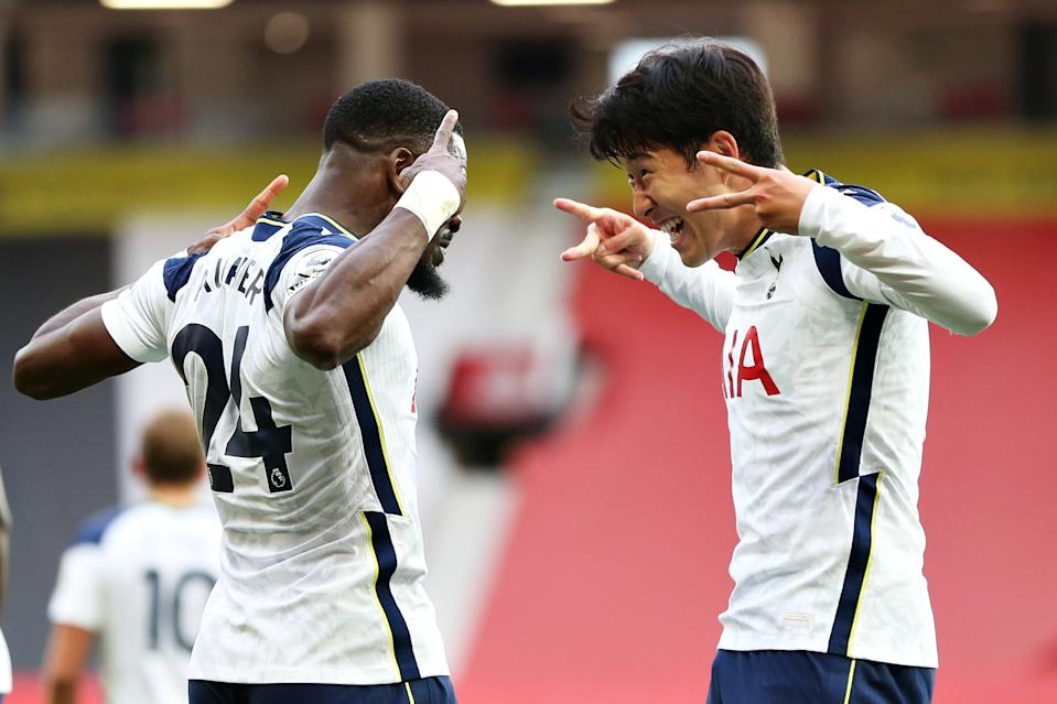 MANCHESTER, ENGLAND - OCTOBER 04: Heung-Min Son of Tottenham Hotspur celebrates with teammate Serge Aurier after scoring his sides fourth goal during the Premier League match between Manchester United and Tottenham Hotspur at Old Trafford on October 04, 2020 in Manchester, England. Sporting stadiums around the UK remain under strict restrictions due to the Coronavirus Pandemic as Government social distancing laws prohibit fans inside venues resulting in games being played behind closed doors. (Photo by Tottenham Hotspur FC/Tottenham Hotspur FC via Getty Images)