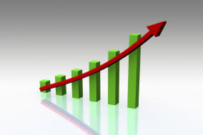 A bar chart in green with a red arrow showing upward trend
