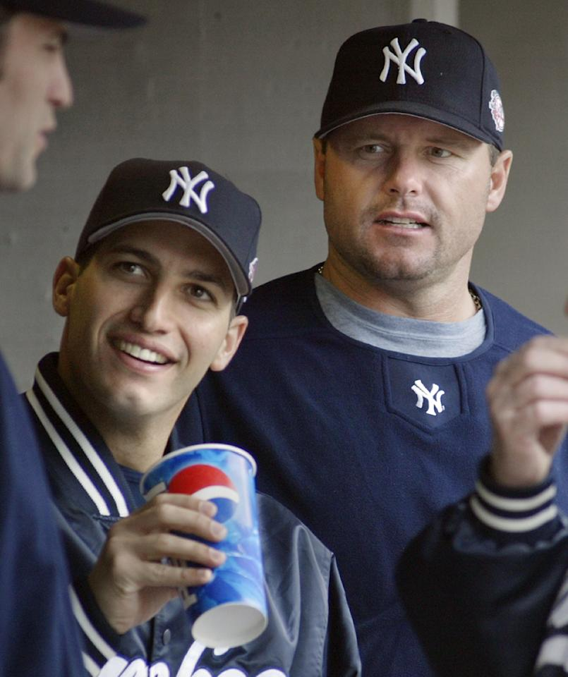 FILE - This May 31, 2003 file photo shows New York Yankees pitchers Andy Pettitte, left, and Roger Clemens talking with a teammate during a baseball game against the Detroit Tigers, in Detroit. Pettitte has taken the stand in the Clemens perjury trial, where Pettitte is expected to testify against his former teammate. Pettitte, who is mounting a comeback with the New York Yankees, arrived at the federal courthouse on Tuesday, May 1, 2012. (AP Photo/Duane Burleson, file)