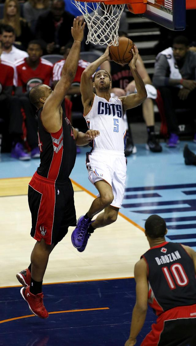Charlotte Bobcats guard Jannero Pargo (5) drives to the basket against Toronto Raptors forward Chuck Hayes in the second half of an NBA basketball game, Monday, Jan. 20, 2014, in Charlotte, N.C. Charlotte won 100-95. (AP Photo/Nell Redmond)
