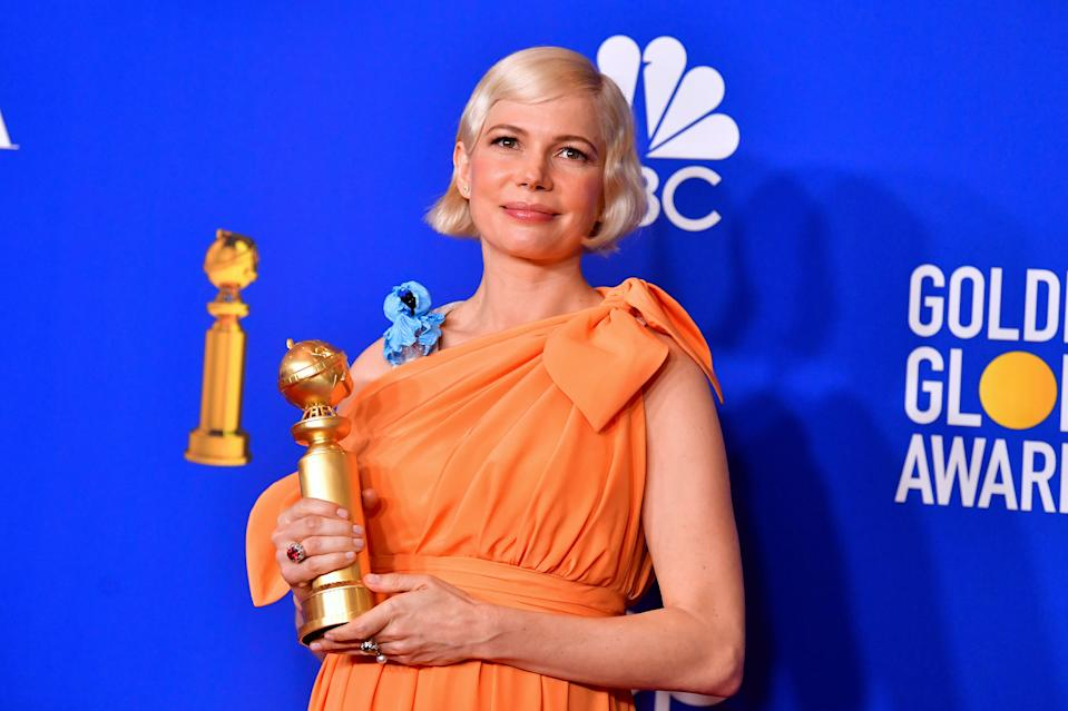 Michelle Williams makes a powerful speech about women's rights while accepting a Golden Globe award. (Photo: Getty Images)