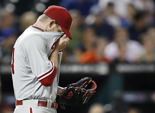 Philadelphia Phillies starting pitcher A. J. Burnett reacts, burying his face in his jersey after allowing a fifth-inning, three-run, home run to New York Mets Travis d'Arnaud in a baseball game against the New York Mets in New York, Monday, July 28, 2014. (AP Photo/Kathy Willens)