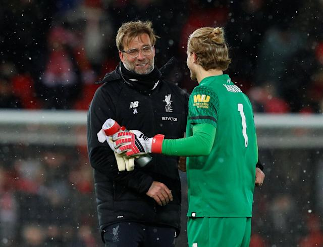 "Soccer Football - Premier League - Liverpool vs Watford - Anfield, Liverpool, Britain - March 17, 2018 Liverpool manager Juergen Klopp and Loris Karius celebrate after the match REUTERS/Phil Noble EDITORIAL USE ONLY. No use with unauthorized audio, video, data, fixture lists, club/league logos or ""live"" services. Online in-match use limited to 75 images, no video emulation. No use in betting, games or single club/league/player publications. Please contact your account representative for further details."