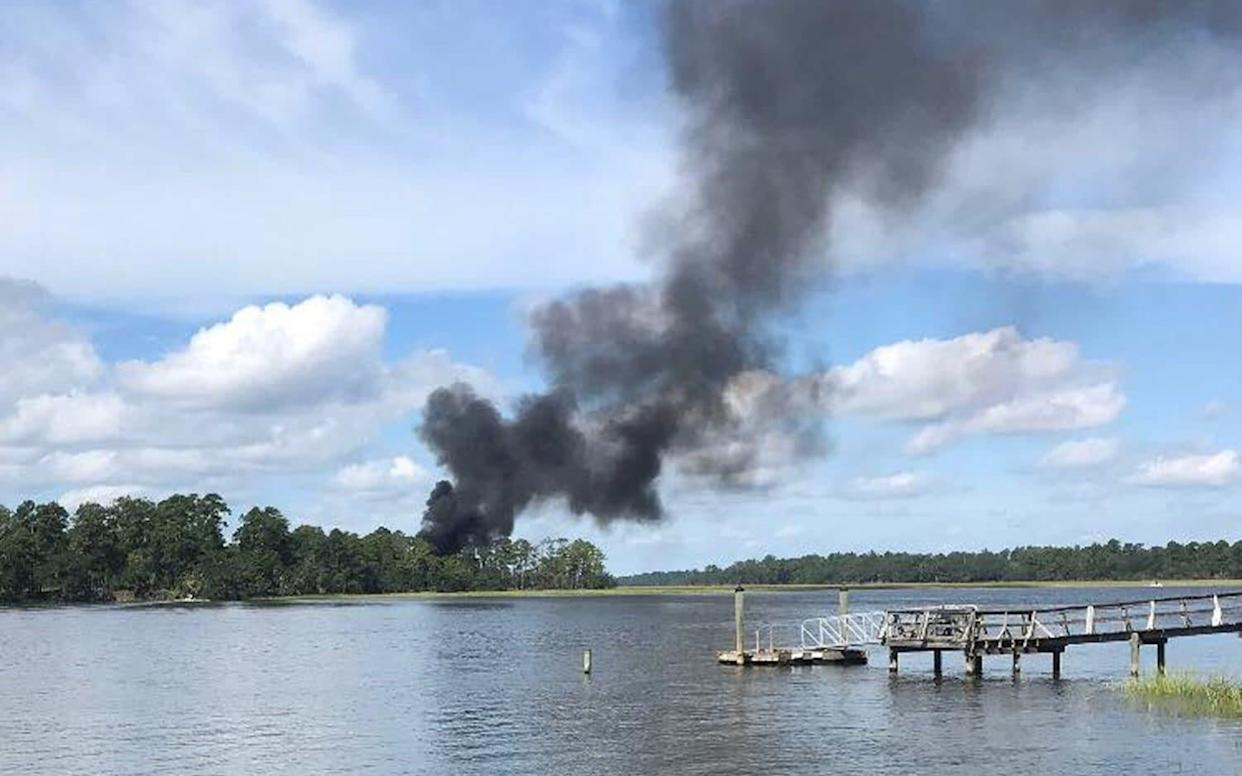 Smoke rises at the site of a F-35 jet crash in Beaufort, South Carolina, US, September 28, 2018. - REUTERS