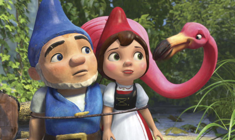"FILE - In this film publicity image released by Touchstone Pictures, Gnomeo, voiced by James McAvoy, left, and Juliet, voiced by Emily Blunt, center, and Featherstone, voiced by Jim Cummings, are shown in a scene from ""Gnomeo and Juliet."" Walt Disney's ""Gnomeo & Juliet,"" an animated 3-D twist on ""Romeo and Juliet,"" took in $14.2 million in its third week of release, leading the box office on Oscar weekend, according to studio estimates Sunday, Feb. 27, 2011. (AP Photo/Touchstone Pictures)"