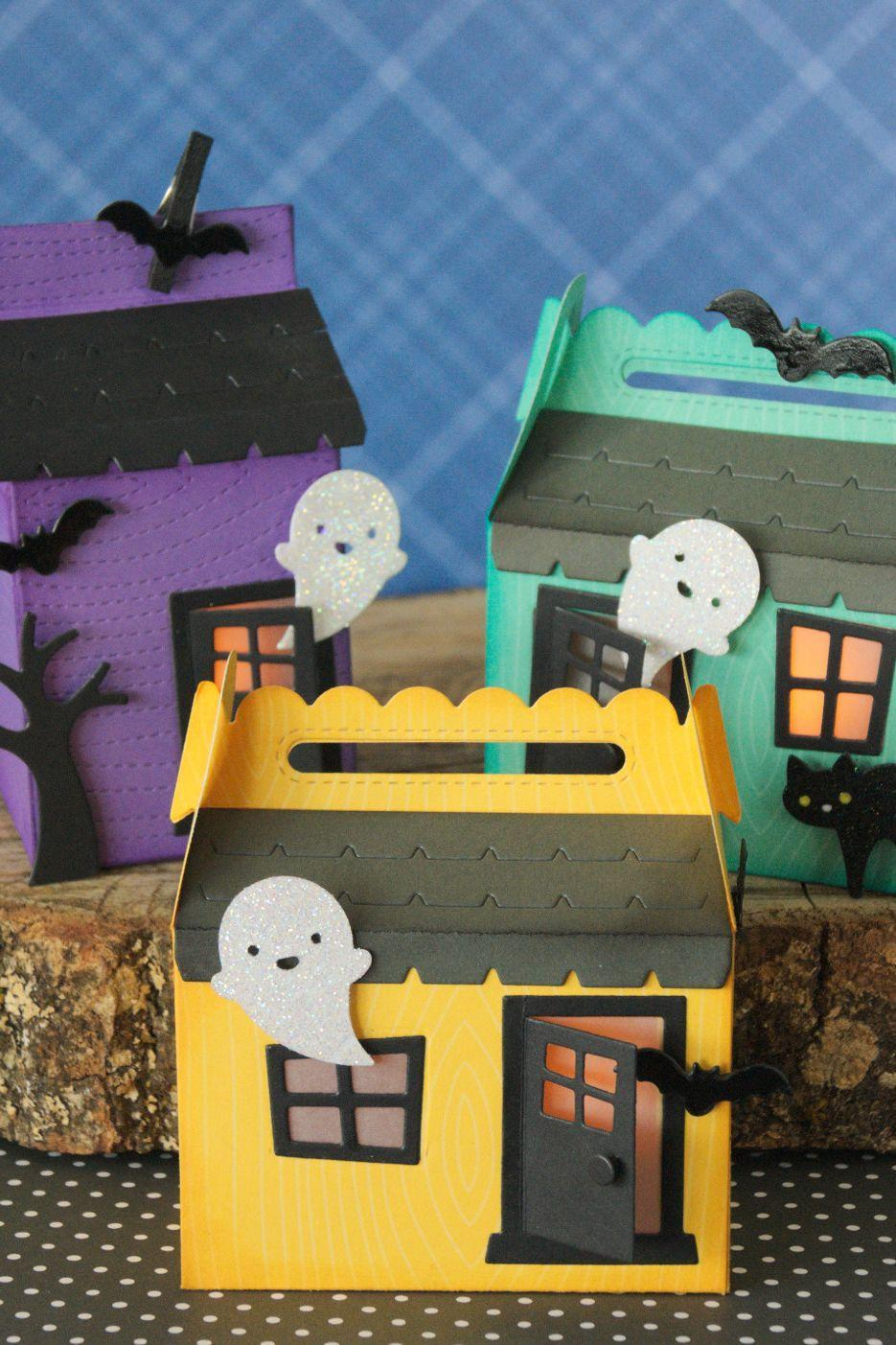 """<p>Paper treat boxes are the perfect base for kids to dream up and decorate their own haunted houses. Make a set and then display them on your mantel (like you would a Christmas village). </p><p><strong>Get the tutorial at <a href=""""https://blog.lawnfawn.com/2017/08/lawn-fawn-intro-scalloped-treat-box/"""" rel=""""nofollow noopener"""" target=""""_blank"""" data-ylk=""""slk:Lawn Fawn"""" class=""""link rapid-noclick-resp"""">Lawn Fawn</a>.</strong> </p>"""