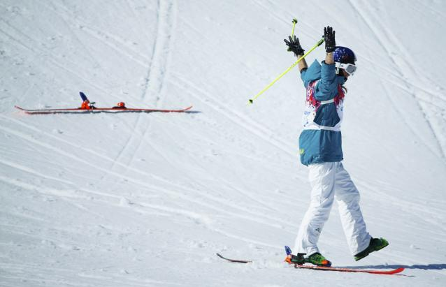Australia's Russell Henshaw reacts after crashing during men's freestyle skiing slopestyle finals at 2014 Sochi Winter Olympic Games in Rosa Khutor