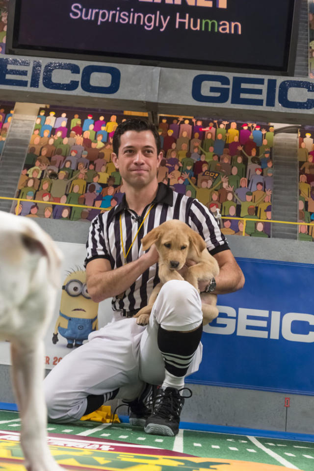 Referee talks to a dog during Puppy Bowl IX.