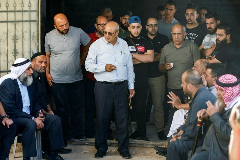 Relatives of Palestinian human rights activist Nizar Banat gather at the family home to mourn his death in Palestinian Authority custody