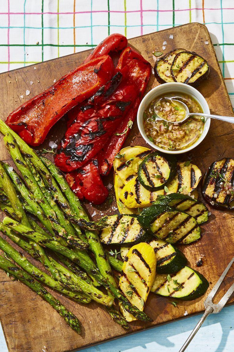 """<p>This grilled medley gets a summer makeover thanks to a sweet, herby drizzle. </p><p><em><a href=""""https://www.goodhousekeeping.com/food-recipes/easy/a21752716/grilled-veggies-with-honey-thyme-vinaigrette-recipe/"""" rel=""""nofollow noopener"""" target=""""_blank"""" data-ylk=""""slk:Get the recipe for Grilled Veggies with Honey-Thyme Vinaigrette »"""" class=""""link rapid-noclick-resp"""">Get the recipe for Grilled Veggies with Honey-Thyme Vinaigrette »</a></em></p><p><strong>RELATED:</strong> <a href=""""https://www.goodhousekeeping.com/food-recipes/g413/great-grilling-recipes/"""" rel=""""nofollow noopener"""" target=""""_blank"""" data-ylk=""""slk:45 Grilling Recipes That Will Be Your New Summer Favorites"""" class=""""link rapid-noclick-resp"""">45 Grilling Recipes That Will Be Your New Summer Favorites</a></p>"""