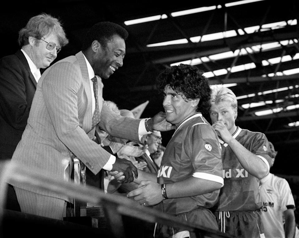 PA Photo 8/8/1987  Diego Maradona is greeted by guest of honour Pele after the Centenary Classic at Wembley in London.   (Photo by PA Images via Getty Images)