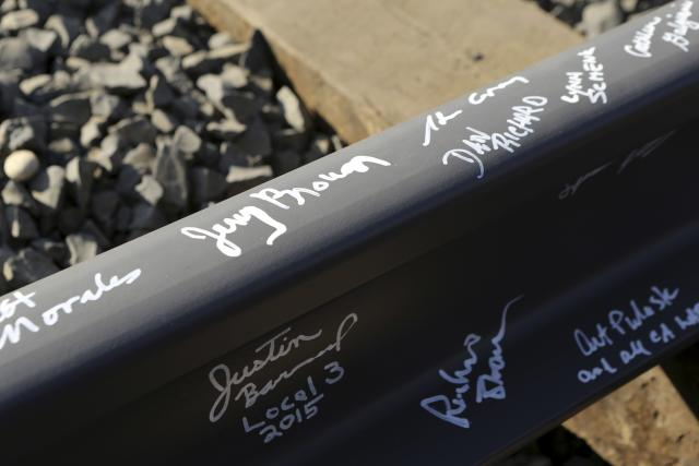 California Governor Jerry Brown's name and others are pictured on a railroad rail after a ceremony for the California High Speed Rail in Fresno, California January 6, 2015. California officials broke ground on Tuesday on its ambitious but controversial high-speed rail project, marking another milestone for Brown and for foreign manufacturers waiting to bid on lucrative train contracts. REUTERS/Robert Galbraith (UNITED STATES - Tags: POLITICS TRANSPORT)