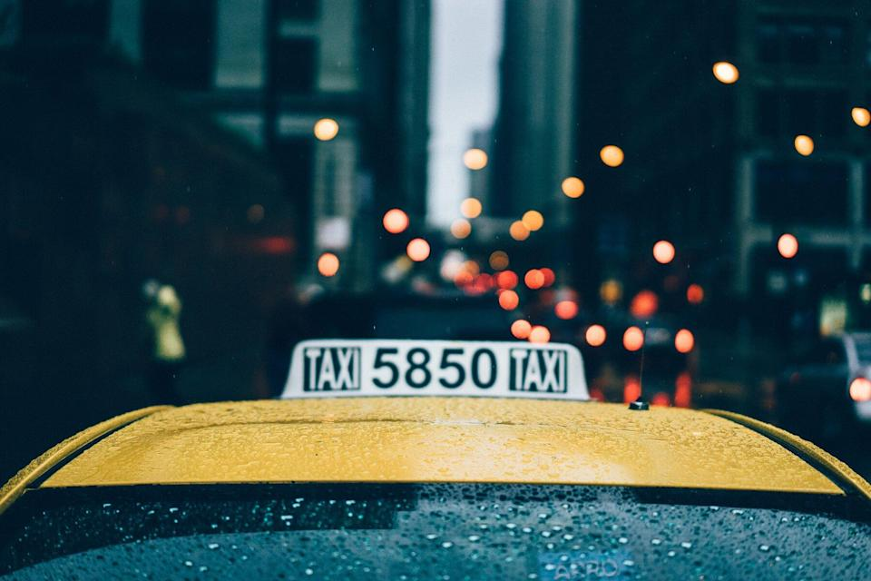 Close of Taxi cab in Chicago as it's raining