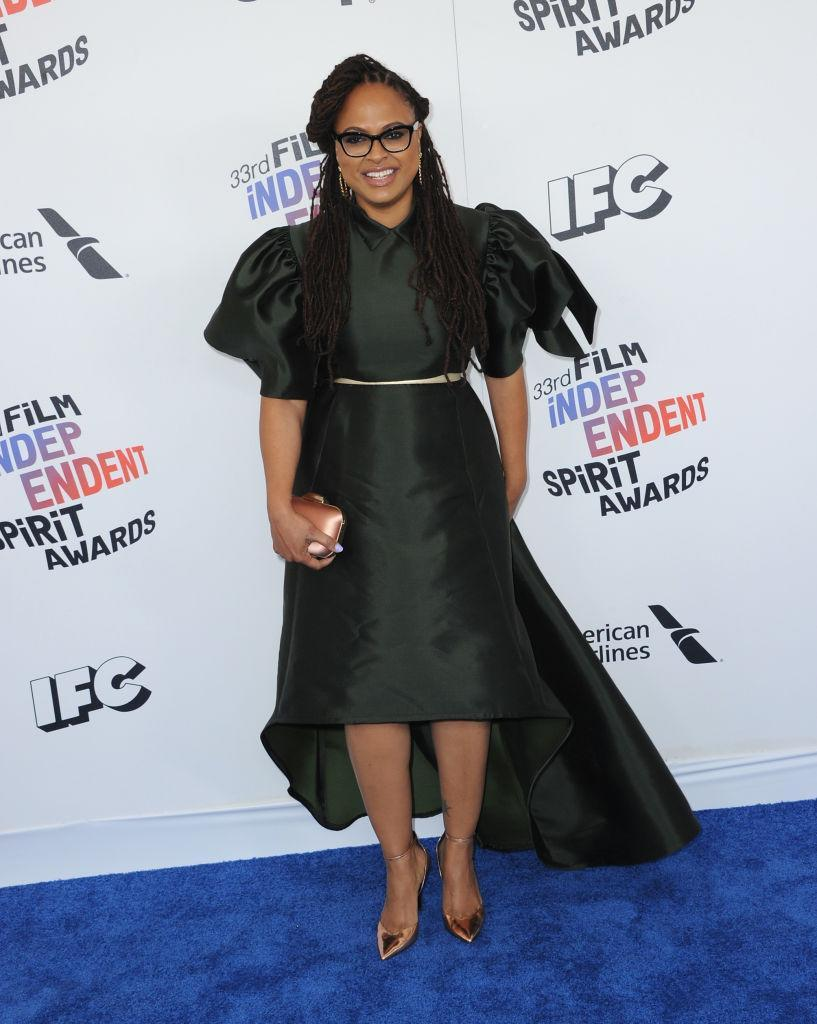 <p>The <em>Wrinkle in Time</em> director embraced volume in the sleeves and skirt of her dramatic black dress, which she accesorized with rose gold heels, belt, and clutch. (Photo: Getty Images) </p>