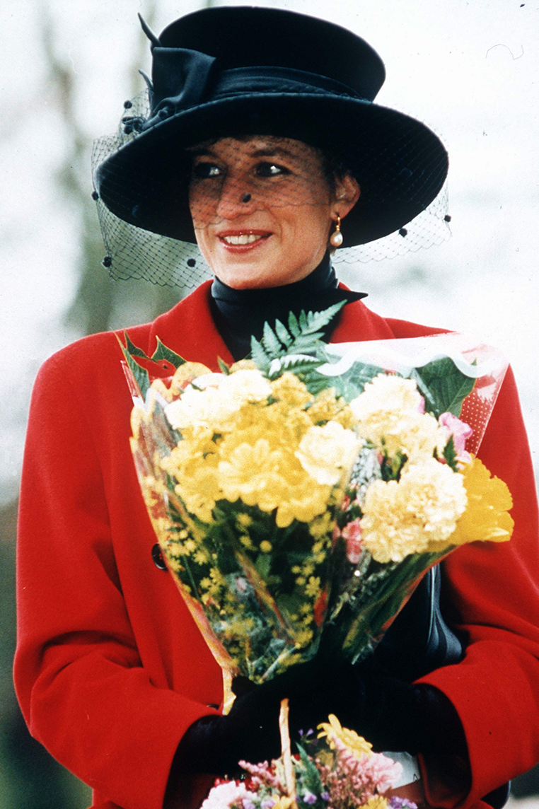 <p>Here's Diana on Christmas Day in 1993, wearing a stylish statement hat complete with a mesh veil and contrasting lipstick red coat. </p>