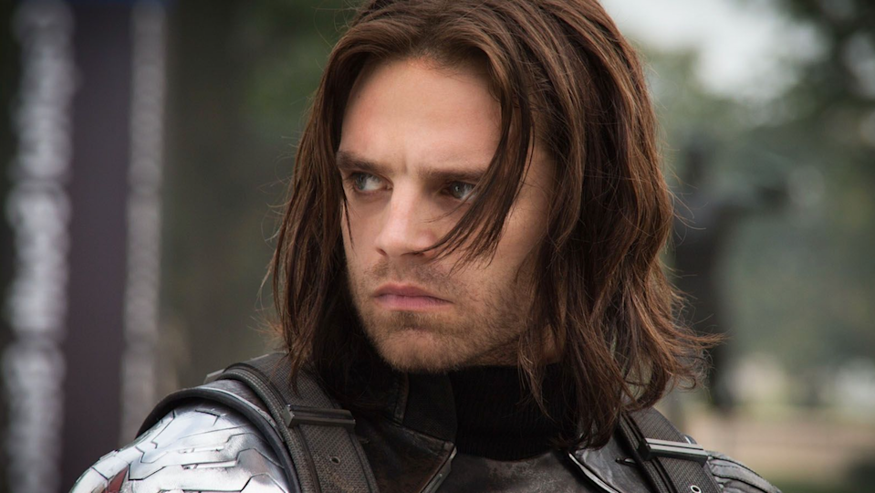 Long-haired Bucky Barnes looking pensive and filled with ennui.