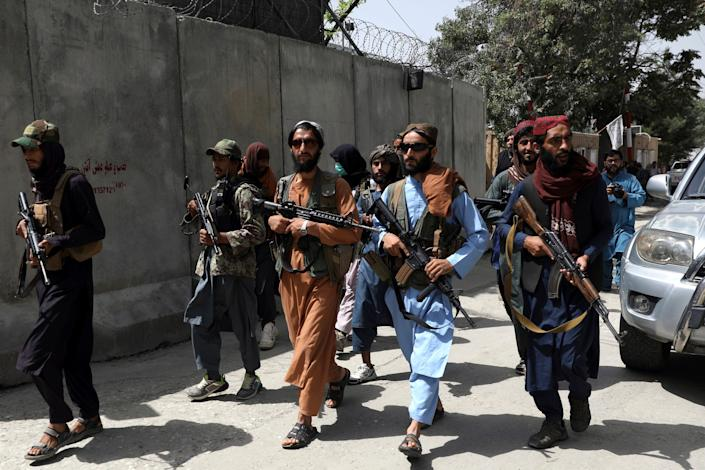 """Taliban fighters patrol in Kabul, Afghanistan, on Aug. 18. The Taliban declared an """"amnesty"""" across Afghanistan and urged women to join their government, seeking to convince a wary population that they have changed."""