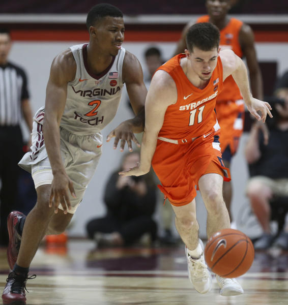 Syracuse's Joseph Girard III (11) steals a pass intended for of Virginia Tech's Landers Nolley II (2) during the first half of an NCAA college basketball game in Blacksburg Va., Saturday, Jan. 18 2020. (Matt Gentry/The Roanoke Times via AP)