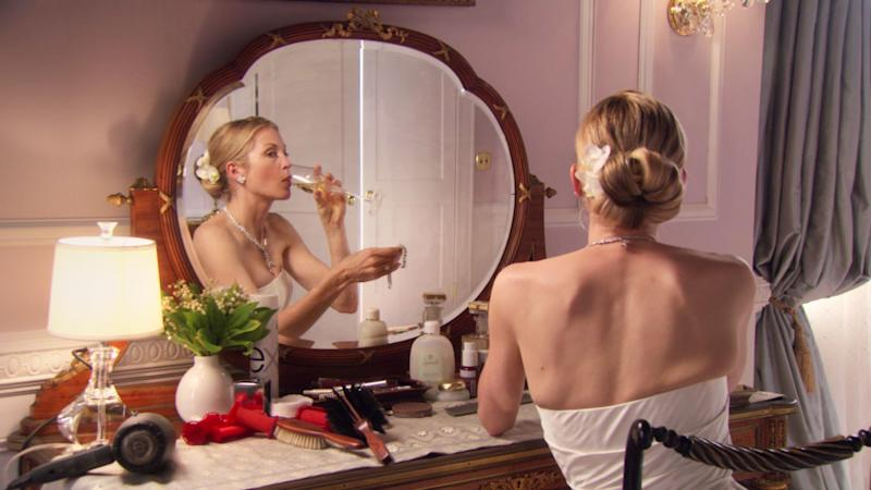 In the season one finale, Lily wears her signature tight bun finished off with a flower hair accessory on her wedding day.