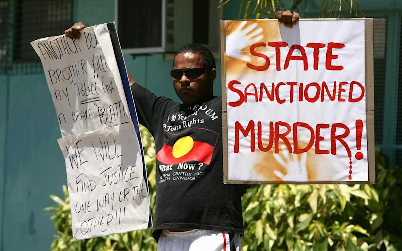 Chris Hurley's acquittal sparks violent protests on Palm Island in 2006 - Credit: Fairfax Media via Getty Images