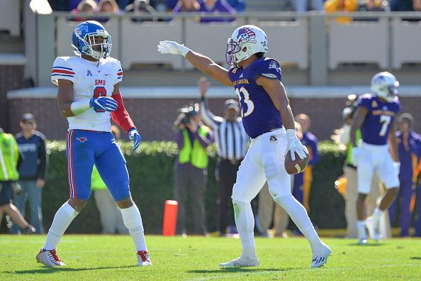 "<a class=""link rapid-noclick-resp"" href=""/ncaaf/players/240897/"" data-ylk=""slk:Quay Johnson"">Quay Johnson</a> motions for a first down against SMU. (Getty Images)."