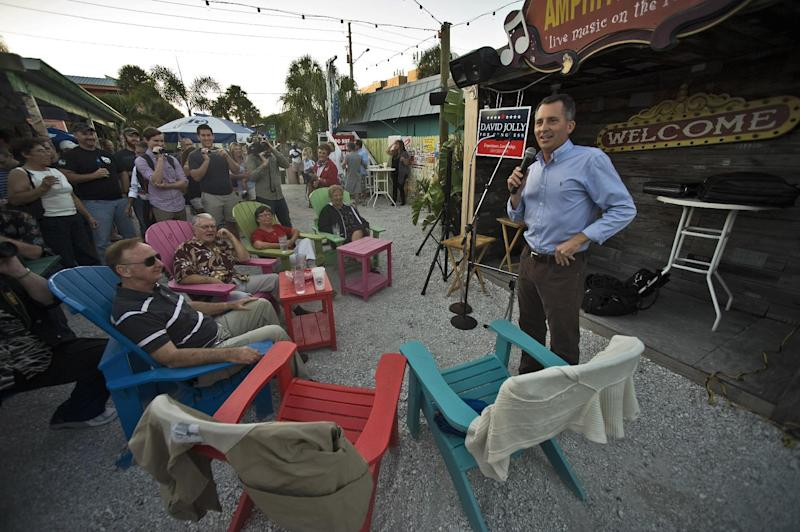 FILE - This Nov. 23, 2013 file photo shows Florida Republican Congressional candidate David Jolly, right, speaking in Indian Rocks Beach, Fla. The special election in this stretch of coastal beach towns and retirement communities was expected to be a referendum on President Barack Obama's health care law. Instead, in the waning days of the spirited campaign to replace the late Rep. Bill Young, another issue has roared to the forefront. (AP Photo/Steve Nesius, File)