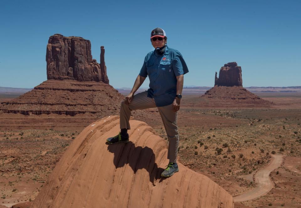 President of the Navajo Nation Jonathan Nez stands in the Monument Valley Tribal Park, which has been closed due to the Covid-19 pandemic in Arizona on May 21, 2020. - Weeks of delays in delivering vital coronavirus aid to Native American tribes exacerbated the outbreak, the president of the hard-hit Navajo Nation said, lashing the administration of President Donald Trump for botching its response. Jonathan Nez told AFP in an interview that of the $8 billion promised to US tribes in a $2.2 trillion stimulus package passed in late March, the first tranche was released just over a week ago. (Photo by Mark RALSTON / AFP) (Photo by MARK RALSTON/AFP via Getty Images)