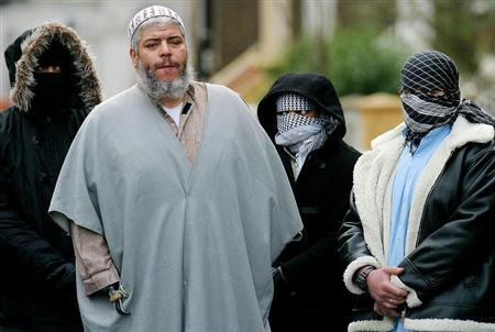 A file photograph dated February 7, 2003 shows Muslim cleric Sheikh Abu Hamza (2L) outside the North London Mosque at Finsbury Park surrounded by supporters.
